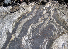 Folded-faulted banded iron formation (Temagami Iron-Formation, Neoarchean, ~2.736 Ga; Temagami North roadcut, Temagami, Ontario, Canada) 3 (James St. John) Tags: temagami ontario canada precambrian archean neoarchean banded formation bif magnetite quartz fault faults fold folds folded faulted