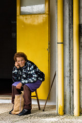'How many more times?' (Canadapt) Tags: woman seated chair urban waiting street lisbon portugal canadapt cane