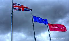 Storm clouds gathering (© Freddie) Tags: london bermondsey se1 lbsouthwark cityhall queenswalk pottersfield morelondon flags londonisopen fjroll ©freddie