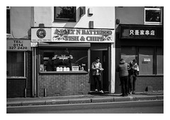 FILM - Chips (fishyfish_arcade) Tags: 35mm analogphotography bw blackwhite blackandwhite canonsureshotz135 filmphotography filmisnotdead hp5 istillshootfilm monochrome analogcamera compact film ilford mono chipshop fishandchips takeaway streetphotography