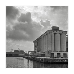 At the harbour (K.Pihl) Tags: rolleiflex35e film monochrome kodaktmax100 aarhusharbour planar75mmrolleiflex rodinal1100 blackwhite schwarzweiss bw pellicolaanalogica analog clouds
