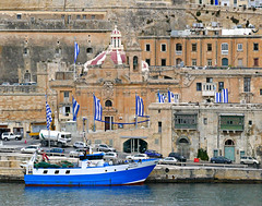 Touch of Blue (Colorado Sands) Tags: malta boat fishingboat port buildings sandraleidholdt harbour flags waterfront valletta city building