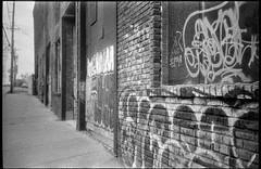 front facade, abandoned warehouse, graffiti, urban decay, Asheville, NC, Rollei XP 140, Rera Pan 320, HC-110 developer, 5.6.19 (steve aimone) Tags: facade warehouses abandoned brick architecture graffiti asheville northcarolina olympusxa4 kodaktrix400 hc110developer 35mm 35mmfilm film monochrome monochromatic blackandwhite analog