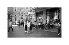 QVB Town Hall, Sydney street 2019  #733 (lynnb's snaps) Tags: 35mm cvultron35mmf2vintagemmo id11 ilfordpanf100 leicacl townhall bw film people street cvultron35mmf2vintagemmount 2019 sydney leicafilmphotography rangefinderphotography rff blackandwhite bianconegro biancoenero blackwhite bianconero blancoynegro noiretblanc schwarzweis monochrome ishootfilm filmfilmforever