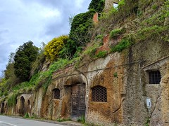 town storage (ekelly80) Tags: italy tuscany april2019 spring pitigliano countryside hills cliff storage garage hidden rock