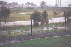 Flooded creek to golf T and power lines.. (spelio) Tags: act canberra historic rain flood catchment riparian
