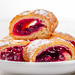 Pieces of cherry strudel on a white plate