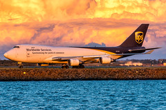 N573UP UPS Boeing 747-44A(F) Sydney Airport SYD/YSSY 4/5/2019 (TonyJ86) Tags: n573up ups 5xups unitedparcelservice boeing b744 b744f b747 747 747400 74744af widebody quadjet aircraft aviation airliner airplane aeroplane plane cargo freight freighter jet jetliner jetaircraft jetplane international arrival landing flight fly airport syd yssy sydneyairport sydneykingsfordsmith sydney nsw newsouthwales australia planespotting avporn aviationporn avgeek travel nikon d750 nikond750 vehicle outdoor water beach aviationphotography tamronsp150600mmf563divcusdg2 tamron sunset goldenhour golden apocalyptic purple purplesky colour color colorful dramatic drama clouds taxi taxiway