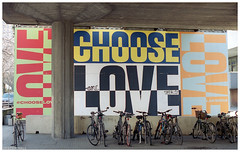 Choose Love (peterphotographic) Tags: img017edwm chooselove southbank southlondon london england uk britain ©peterhall leica leicam6 summarit summaritm35mmf25 film 35mm analog scanned filmsnotdead kodak portra portra400 prime wideangle poster sign bicycle cycle bike love