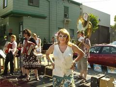 Milwaukee Pridefest, 2009: Laurette, Seen With The Squeezettes (Laurette Victoria) Tags: laurette woman brunette milwaukee pridefest sunglasses squeezettes