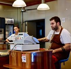 Unwelcome (Max Sat) Tags: bakery boulangerie faché femme homme maxsat maxwellsaturnin milan milano pasticceria unhappy fuji xpro1 fujinon xf35
