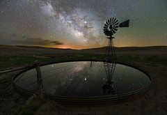Heavenly Reflections (Erik Johnson Photography) Tags: purple astrophotography milky way night sky stars long exposure core galaxy galactic reflection windmill rural ranch remote farm agriculture nebraska sandhills hyannis mullen gordon light pollution nature