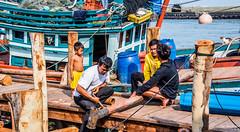 2019 - Cambodia - Sihanoukville - Tumnuk Rolok (Ted's photos - For Me & You) Tags: 2019 cambodia cropped nikon nikond750 nikonfx tedmcgrath tedsphotos vignetting tumnukrolok tumnukroloksihanoukville sihanoukvillecambodia tumnukrolokcambodia family cat boat port fishingboat fishinggear ក្រុងព្រះសីហនុ