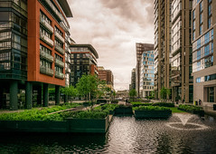Also London (Мaistora) Tags: buildings archtecture water reflection fountain reflections spray funnel cone green trees plants flowers garden urban nature modern contemporary offices residential development complex area park canal basin union grand paddington london england britain uk sky clouds skyline cloudy colours weather drama light shadows leica dlux typ109 lightroom aurora luminar