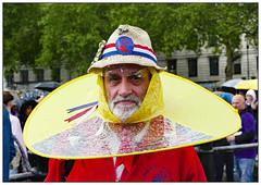 Do I look daft in this? (donbyatt) Tags: london trafalgarsquare westminsterdayofdance morrisdancing people street portrait wet rain