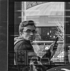 RX100 (daveson47) Tags: window reflection mono monochrome bw blackandwhite people eyecontact candid street streetphotography urban city minneapolis sony sonyrx100 rx100