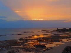 A touch of gold from a small window of light. Victoria - Australia (rosgloryfire) Tags: seascapes australia ocean scenic reflections rocks dusk water olympus light moodyskies clouds skydrama bluehour sunset sun sea sky nature landscapes