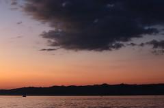 Lake Petén Itzá Twilight (peterkelly) Tags: digital canon 6d flores lakepeténitzá northamerica gadventures mayandiscovery guatemala centralamerica lake water cloud sunset evening dusk orange boat