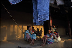 leisure, chichigaontha (nevil zaveri (thank you for 15+ million views:)) Tags: zaveri rural dang chichigaontha village gujrat india images stockimages gujarat nevil nevilzaveri stock photo swing people woman women man men young shadows drying clothes porch mudhouse