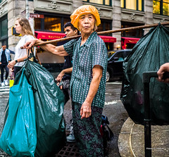 The New Yorkers - NYC Canner (François Escriva) Tags: street streetphotography us usa nyc ny new york people candid olympus omd photo rue sun light woman colors sidewalk manhattan bags canner can cans hat orange green red shirt