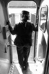 16-8399bw (George Hamlin) Tags: virginia williamsburg railroad passenger train amtrak northeast regional atk 67 conductor vestibule budd amfleet coach door opening station silhoutte vertical photo decor george hamlin photography monochrome black white light shadow