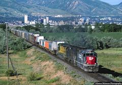 On the Road to Oakland (jamesbelmont) Tags: southernpacific unionpacific chicagonorthwestern riogrande drgw gp60 sd40t2 c408 ge emd ahnoa bangerterhighway saltlakecity utah skyline westernpacific railroad railway train locomotive