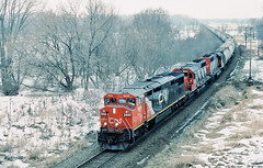 CN 2444 east in LaCrosse, Wisconsin on February 7, 1993. (soo6000) Tags: c408m ge barn lacrosse wisconsin swamp winterfog aurorasub bn trackagerights cn760 potash unittrain train railroad freight