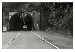 Sailor Bar Tunnel (1959) (Robert Drozda) Tags: britishcolumbia canada fraserrivercanyon transcanadahighway sailorbartunnel road sign tunnel rock mountain light monochrome fbxtopdx2018 drozda