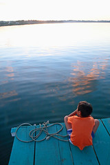 The Boy At The Back Of The Boat (peterkelly) Tags: guatemala peten flores digital canon 6d northamerica gadventures mayandiscovery centralamerica lakepeténitzá water sunset dusk evening boy pontoon boat blue orange lake rope