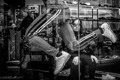 the runner (Gerrit-Jan Visser) Tags: amsterdam blackandwhite bnw runner shoes shop streetphotography