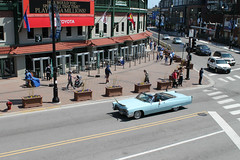 On Parade (Flint Foto Factory) Tags: chicago illinois urban city spring may 2019 cincodemayo may5th sunny sunday game day chicagocubs baseball sports team dutchdocs 3600 nclarkst clark addison intersection brunch 1967 cadillac coupe deville convertible powder blue generalmotors gm luxury car dream boat wrigleyfield cubbybear bar restaurant openair dining