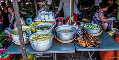 2019 - Cambodia - Sihanoukville - Phsar Leu Market - 11 of 25 (Ted's photos - Returns late November) Tags: 2019 cambodia cropped nikon nikond750 nikonfx tedmcgrath tedsphotos vignetting wideangle widescreen food pots scale weighscale ladles spoons people phsarleumarket phsarleumarketsihanoukville sihanoukvillephsarleumarket sihanoukville sihanoukvillecambodia market marketfood soup soups table tables