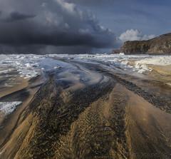 Outgoing Meets Incoming (SkyeWeasel) Tags: scotland hebrides outerhebrides lewis mangurstadh beach sand sandpatterns landscape seascape storm rain ngc npc