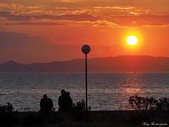 Sunset (mary.th) Tags: people sunset sky sea sun trees streetlight clouds mountains