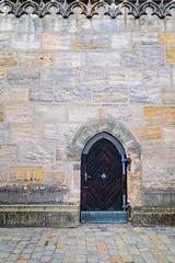 A side door into St Martin (Brett of Binnshire) Tags: ornamentation church locationrecorded franconia germany bavaria wall architecture forchheim door bayern on1raw