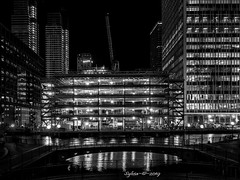 Novotel (Sy at sswhite11) Tags: canarywharf london buildings crane novotel lights water bridge blackandwhite construction
