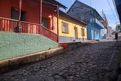 Cobblestone Colours (peterkelly) Tags: digital canon 6d northamerica centralamerica gadventures mayandiscovery guatemala flores cobblestone street road house home man yellow blue orange colours color colour colors