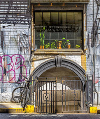 """Clinton Street, LES Architecture and Building Front (nrhodesphotos(the_eye_of_the_moment)) Tags: dsc31163001084 """"theeyeofthemoment21gmailcom"""" """"wwwflickrcomphotostheeyeofthemoment"""" architecture building brick windows gate metal reflections shadows outdoors art graffiti nyc basement flowerpots"""
