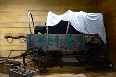 Old covered wagon inside Tabernacle, Council Bluffs (ali eminov) Tags: councilbluffs iowa kanesvilletabernacle wagons coveredwagon