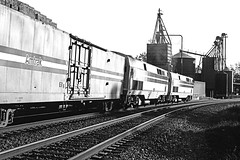 rr81-87bw (George Hamlin) Tags: virginia culpeper railroad passenger train amtrak atk 20 northbound crescent material handling car grain elevator general electric p40 genesis diesel locomotives fade paint scheme curve monochrome black white sky track photo decor george hamlin photography