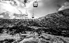 Going up the mountain (NikNak Allen) Tags: scotland scottish highlands scottishhighlands ski lift skilift winter snow grey greys black white blackandwhite mountain mountains sky clouds longexposure trees