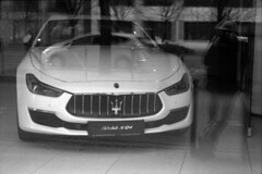 Self Portrait with Maserati in the window (lumpy79) Tags: praktica mtl5 helios44m 258 ilford hp5 400 1600 self portrait maserati window budapest feketefehér blackandwhite bw