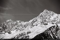Aiguille du Midi (Ludtz) Tags: ludtz canon canonae1 canonae1program ae1 film negative analog kodaktrix400 kodak bw noirblanc mountain montagne mountains montagnes alps alpes rhônealpes hautesavoie 74 canonfd fdsystem canonfdn2885 4 neige snow spring printemps