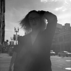 untitled (kaumpphoto) Tags: rolleiflex 120 tlr ilford bw black white street urban city minneapolis bright light hair woman portrait glasses lamp