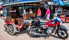 2019 - Cambodia - Sihanoukville - Phsar Leu Market - 18 of 25 (Ted's photos - For Me & You) Tags: 2019 cambodia cropped nikon nikond750 nikonfx tedmcgrath tedsphotos vignetting motorcycle tuktuk streetscene street peopleandpaths pathsandpeople umbrella wheels phsarleumarket sihanoukville sihanoukvillecambodia sihanoukvilleuppermarket red redrule taxi people canopy boxer shadow