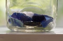 Thames foreshore glass (Spannarama) Tags: glass shards pieces jar window tree leaves backlit seaglass windowsill blueglass