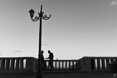 Just talking. (tzevang.com) Tags: light piraeus people x100f fujifilm talking bw greece silhouettes