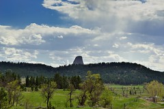 Even from Miles Away and then You See It the First Time... (Devils Tower National Monument) (thor_mark ) Tags: 1558m 5112ft alongroadside azimuth226 bearlodge bearlodgebutte bearlodgemountains bellefourchelittlemissouriarea blackhills blueskies bluesskieswithclouds butte capturenx2edited colorefexpro day7 devilstower devilstowernationalmonument grassland grassyarea grassyfield grassymeadow greatplains hillsideoftrees igneousrock laccolithicbutte landscape lookingsw mixedgrassprairieecosystem nature nikond800e northamericaplains outside partlycloudy pinusponderosa ponderosapine prairiegrass prairiegrasses project365 roadside roadsidepulloff roadsidestop sunny trees triptodakotas triptodakotasandwyoming wyo24 wyominghighway24 hulett southdakota unitedstates