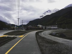 (i threw a guitar at him.) Tags: clouds cloudy mountains buildings tracks railroad challenge smoking quit photo iphone town street broadway 2019 spring alaska skagway