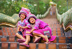 Two Sweet Girls at Doi Suthep Temple, Thailand - Ben Heine Photography (Ben Heine) Tags: hug hmong asia cute dress fashion young thai background play ceremony female girl child tribal sisters year karen ethnic temple white kayan asian face hill smile art laugh little people person monument vintage petite costume children new culture girls minority colorful pai beautiful travel nymphet friends portrait outdoor stairs thailand traditional happy doisuthep chinese pink sweet